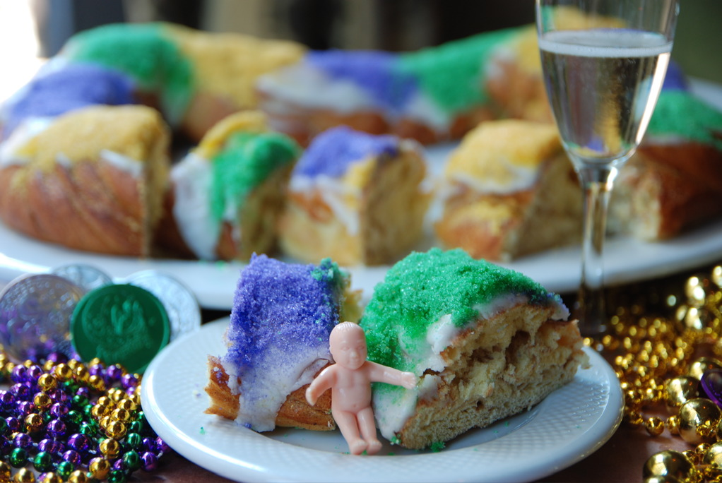 King-Cake-with-Baby-and-Champagne-credit-New-Orleans-Convention-and-Visitors-BureauJoyce-Bracey